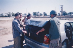 The wired-up trunk of the mid-sized sedan at Camp Doha