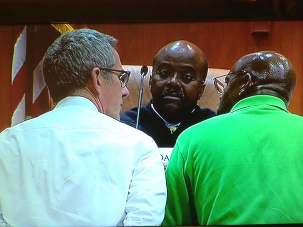Judge Gregory Adams is bored by WXIA's Doug Richards and WSB photographer Tony Light.