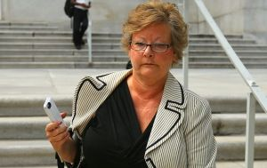 Elaine Boyer clutches her iPhone en route to federal prison. AJC photo